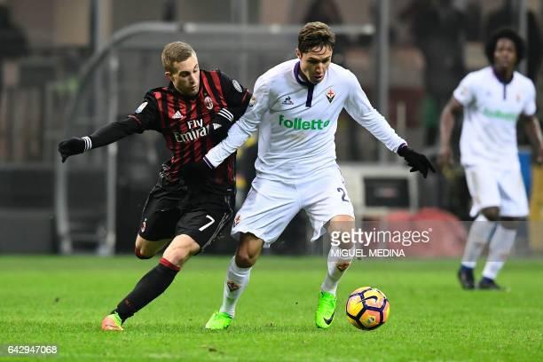 Fiorentina's Italian forward Federico Chiesa vies with AC Milan's Spanish forward Gerard Deulofeu during the Italian Serie A football match between...
