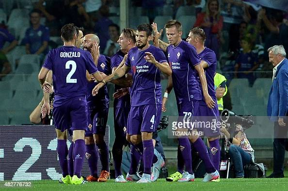 Fiorentina's Italian midfielder Federico Bernardeschi celebrates with teammates after scoring a goal during the International Champions Cup football...