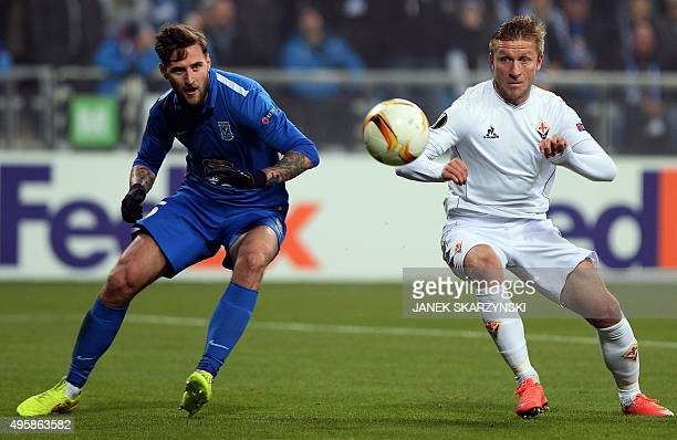 Fiorentina's Jakub Blaszczykowski vies for the ball with KKS Lech Poznan's Tamas Kadar during the UEFA Europa League football match KKS Lech Poznan...