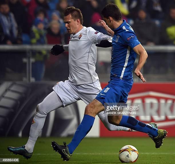 Fiorentina's Josip Ilicic and KKS Lech Poznan's Marcin Kaminski vie for the ball during the UEFA Europa League football match KKS Lech Poznan vs ACF...