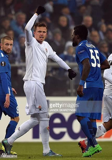 Fiorentina's Josip Ilicic reacts after scoring a goal next to Abdul Aziz Tetteh and Szymon Pawlowski from KKS Lech Poznan during the UEFA Europa...