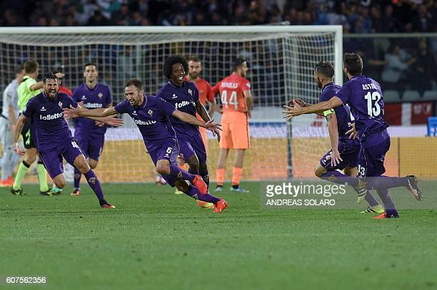 Fiorentina's midfielder from Croatia Milan Badelj celebrates with teammates after scoring against AS Roma during the Italian Serie A football match...