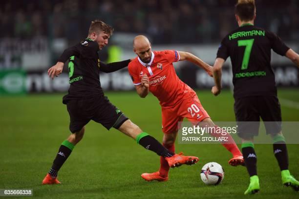 Fiorentina's midfielder from Spain Borja Valero and Moenchengladbach's midfielder Tobias Strobl vie for the ball during the UEFA Europa League round...