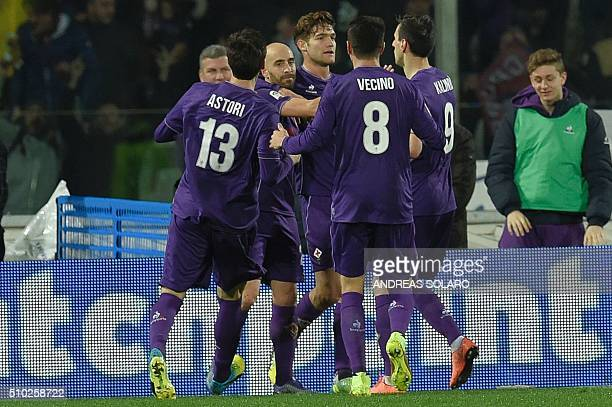 Fiorentina's midfielder from Spain Borja Valero celebrates with teammates after scoring a goal during the Italian Serie A football match Fiorentina...
