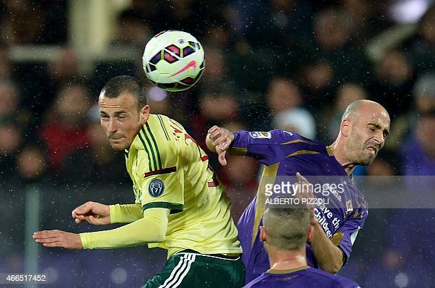 Fiorentina's midfielder from Spain Borja Valero fights for the ball with AC Milan's defender Luca Antonelli during the Italian Serie A football match...