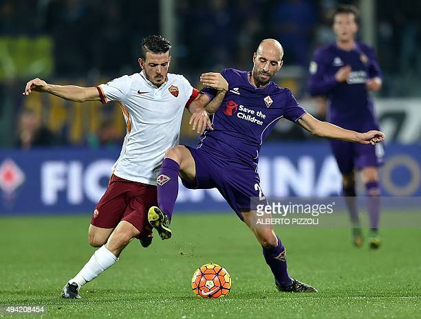 Fiorentina's midfielder from Spain Borja Valero fights for the ball with Roma's midfielder from Italy Alessandro Florenzi during the Italian Serie A...