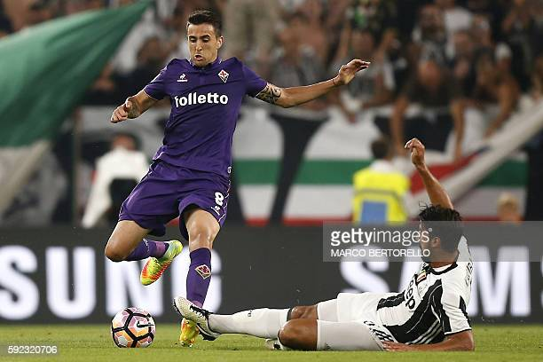 Fiorentina's midfielder Matias Vecino of Uruguay vies for the ball with Juventus' midfielder Sami Khedira from Germany during the Italian Serie A...