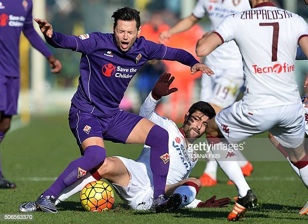 Fiorentina's midfielder Mauro Zarate fights for the ball with Torino's defender from Italy Davide Zappacosta during the Italian Serie A football...