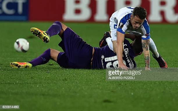Fiorentina's midfielder Sebastian Cristoforo from Uruguay fights for the ball with FC Slovan Liberec midfielder Jan Sykora from Czech Republic during...