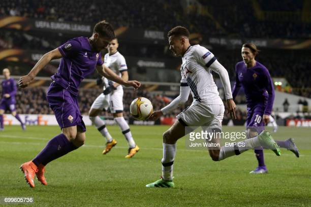 Fiorentina's Nenad Tomovic and Tottenham Hotspur's Dele Allii battle for the ball