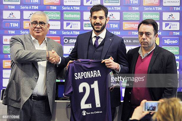 Fiorentina's new attacking midfielder Riccardo Saponara poses for photographers with the General Director of technical area Pantaleo Corvino and the...