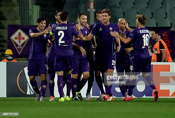 Fiorentina's players celebrate during the UEFA Europa League football match Fiorentina vs Basel on September 17 2015 at the Artemio Franchi Stadium...
