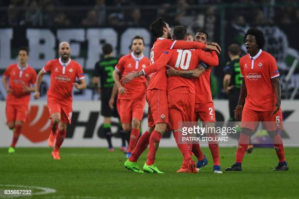 Fiorentina's players celebrate scoring during the UEFA Europa League round of 32 firstleg football match between Borussia Moenchengladbach and...