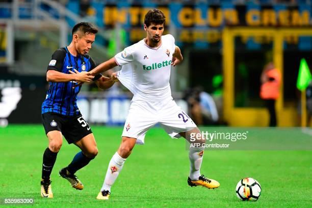 Fiorentina's Portuguese midfielder Gil Dias vies with Inter Milan's Japanese defender Yuto Nagatomo during the Italian Serie A football match Inter...