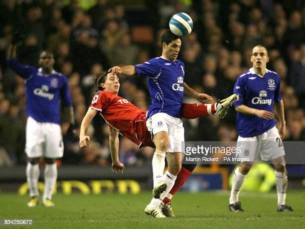 Fiorentina's Riccardo Montolivo and Everton's Mikel Arteta battle for the ball