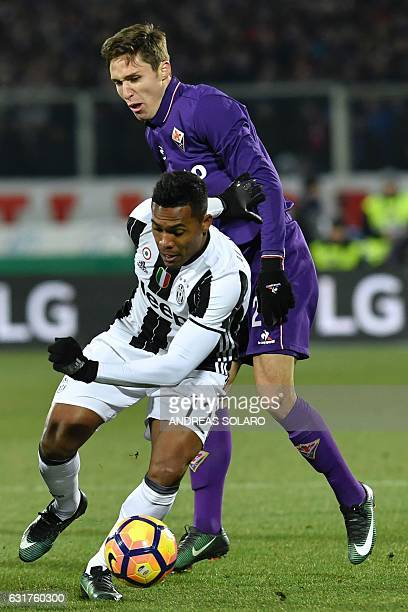 Fiorentina's Romanian goalkeeper Ciprian Anton Tatarusanu vies for the ball with Juventus' Brazilian defender Alex Sandro during the Italian Serie A...