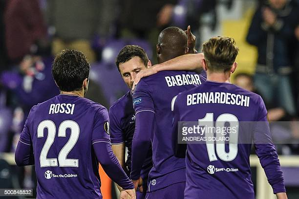 Fiorentina's Senegalese forward Khouma Babacar celebrates with teammates after scoring a goal during the UEFA Europa League Group I football match...