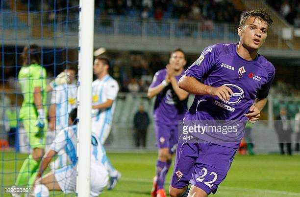 Fiorentina's Serbian forward Adem Ljalic reacts after scoring during the Italian Serie A football match Pescara Calcio vs ACF Fiorentina on May 19...