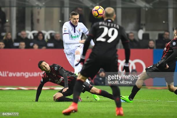 Fiorentina's Slovenian forward Josip Ilicic kicks the ball between AC Milan's Argentinian defender Leonel Vangioni and AC Milan's Argentinian...