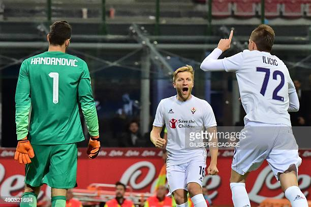 Fiorentina's Slovenian midfielder Josip Ilicic celebrates after scoring a penalty during the Serie A football match between Inter Milan and...