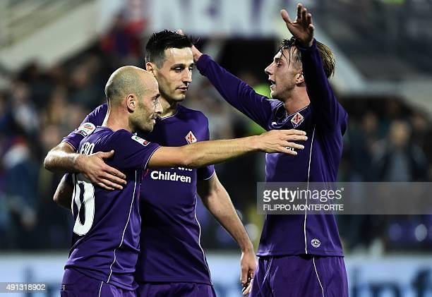 Fiorentina's Spanish midfielder Borja Valero celebrates with teammates Fiorentina's Croatian forward Nikola Kalinic and Fiorentina's Italian forward...