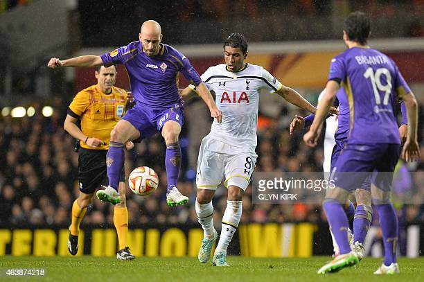 Fiorentina's Spanish midfielder Borja Valero controls the ball under pressure from Tottenham Hotspur's Brazilian midfielder Paulinho during the UEFA...