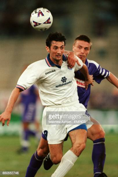 Fiorentina's Tomas Repka pulls back Hadjuk Split's Mate Baturina