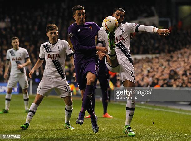 Fiorentina's Uruguayan forward Matias Vecino vies with Tottenham Hotspur's Belgian midfielder Nacer Chadli during the UEFA Europa League round of 32...