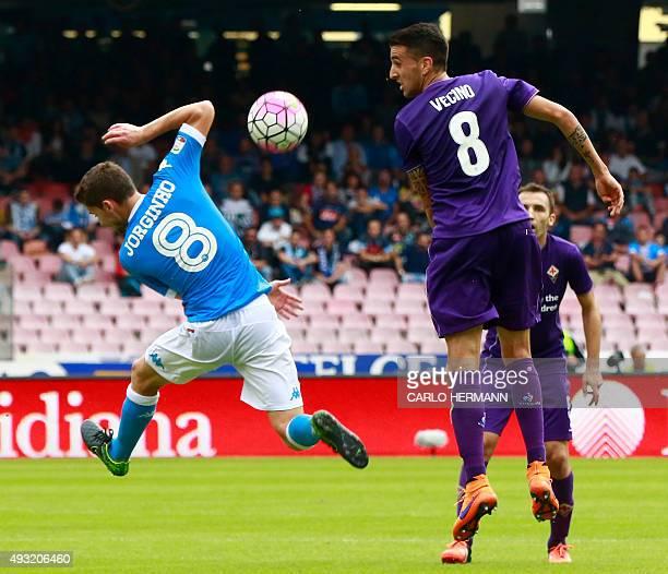 Fiorentina's Uruguayan midfielder Matias Vecino vies with Napoli's Brazilian midfielder Jorginho during the Italian Serie A football match SSC Napoli...