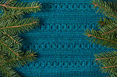 Fir tree as frame on knitted sweater background. Christmas concept. Abstract pattern. Flat lay.