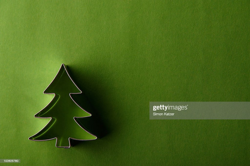 fir tree cake pan on green ground : Stock Photo