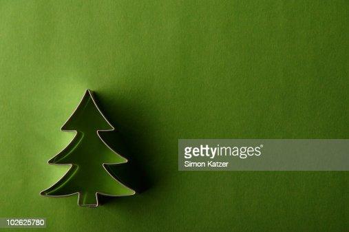 fir tree cake pan on green ground : Stock Photo