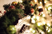 Warm soft glow of Christmas lights against a green garland hung on the mantle. Beautiful soft warmth and colors of Christmas.