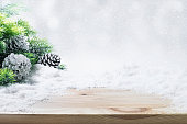 Fir tree,pine cones,snow on wooden table.Christmas ornament decoration concepts background