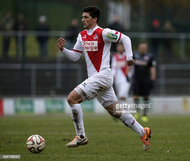 Firat Tuncer of Koeln runs with the ball during the Regionalliga West match between 1 FC Koeln II and RotWeiss Essen at FranzKremerStadion on...