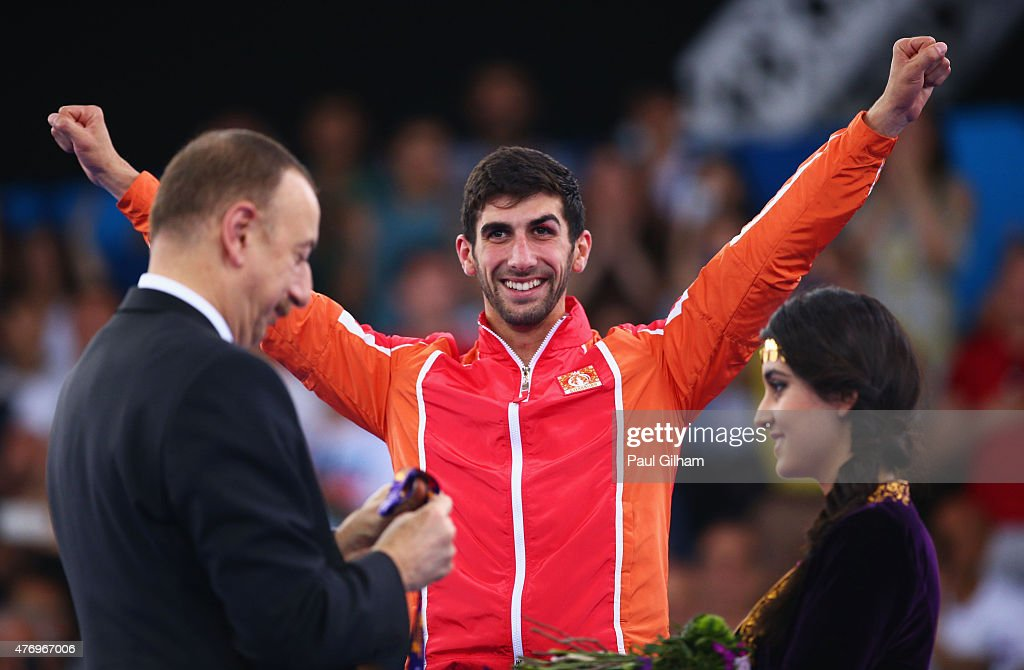 Firdovsi Farzaliyev of Azerbaijan is presented with his gold medal by President of Azerbaijan <a gi-track='captionPersonalityLinkClicked' href=/galleries/search?phrase=Ilham+Aliyev&family=editorial&specificpeople=565601 ng-click='$event.stopPropagation()'>Ilham Aliyev</a> during the medal ceremony for the Men's Kumite -60kg gold on day one of the Baku 2015 European Games at Crystal Hall on June 13, 2015 in Baku, Azerbaijan.