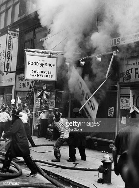 A fire above the Five Food Shop and Albert's Shoe Outlet in New York City circa 1948