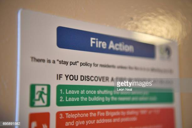 A fire action sign is displayed inside a block near the 24 storey residential Grenfell Tower block in Latimer Road West London in the early hours of...