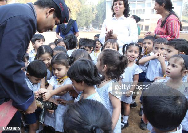 Fire and Security Association of India impart safety tips to school children of St Peter's High at Mazgaon on Thursday