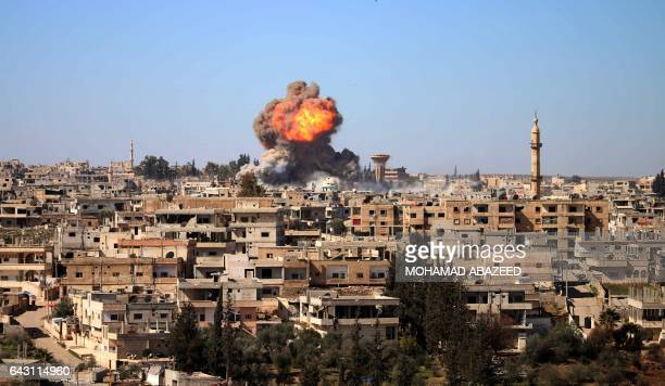 Fire and smoke billow following a reported car bomb explosion at a Syrian progovernment position during clashes between rebel fighters and regime...