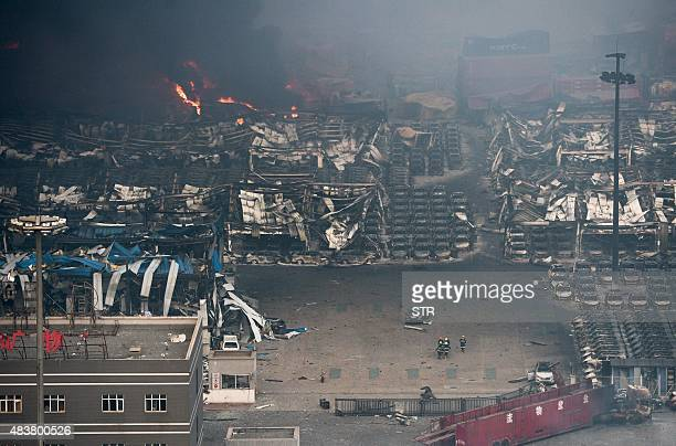 Fire and smoke rise at the site of the massive explosions in Tianjin on August 13 2015 Enormous explosions in a major Chinese port city killed at...