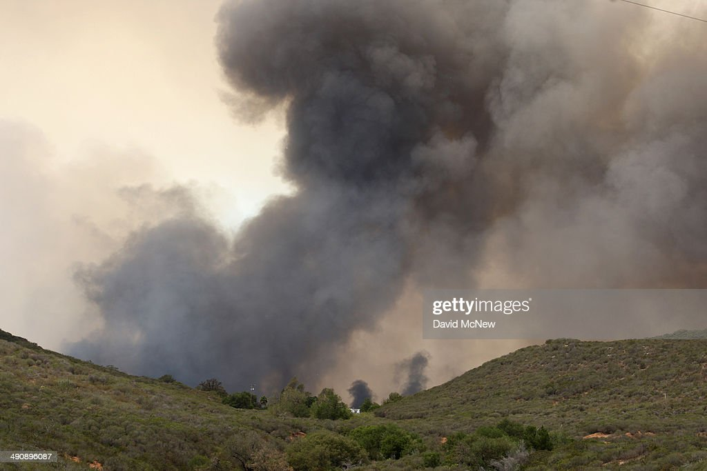 Fire approaches ranch houses surrounded by chaparral brush as the southeast flank of the Cocos fire moves toward near Del Dios Highway on May 15 2014...