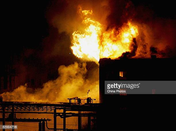 Fire balls erupt after an explosion at a chemical plant on January 18 2005 in Beijing China The cause of the accident is under investigation and...
