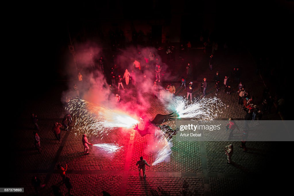 Fire beasts correfoc at night from high angle view