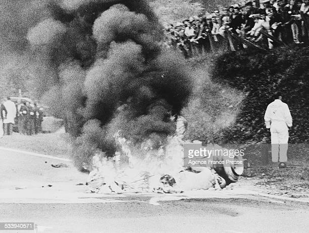 Fire blazes from the burning magnesium of the Honda Racing Honda RA302 Honda V8 of Jo Schlesser of France who was killed on the second lap of the...