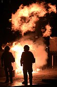 A fire bomb explodes behind riot police during a demonstration in Athens on July 22 2015 Prime Minister Alexis Tsipras faced a new test of his...