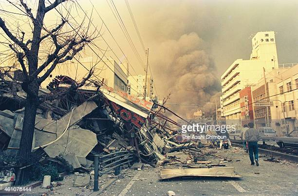 Fire breaks out from the destroyed houses after the strong earthquake on January 17 1995 in Kobe Hyogo Japan Magnitude 73 strong earthquake jolted in...