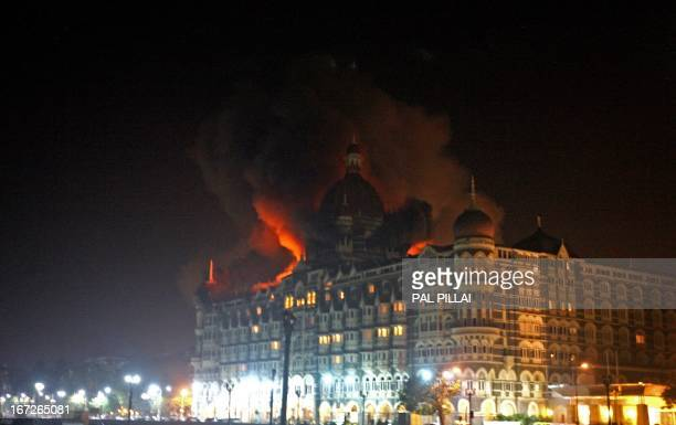 A fire breaks out of the dome of the Taj hotel in Mumbai on November 26 2008 Nearly 80 people were killed in a series of shootings and blasts across...