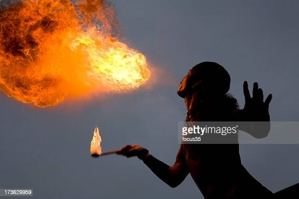 A fire breathing person at an act