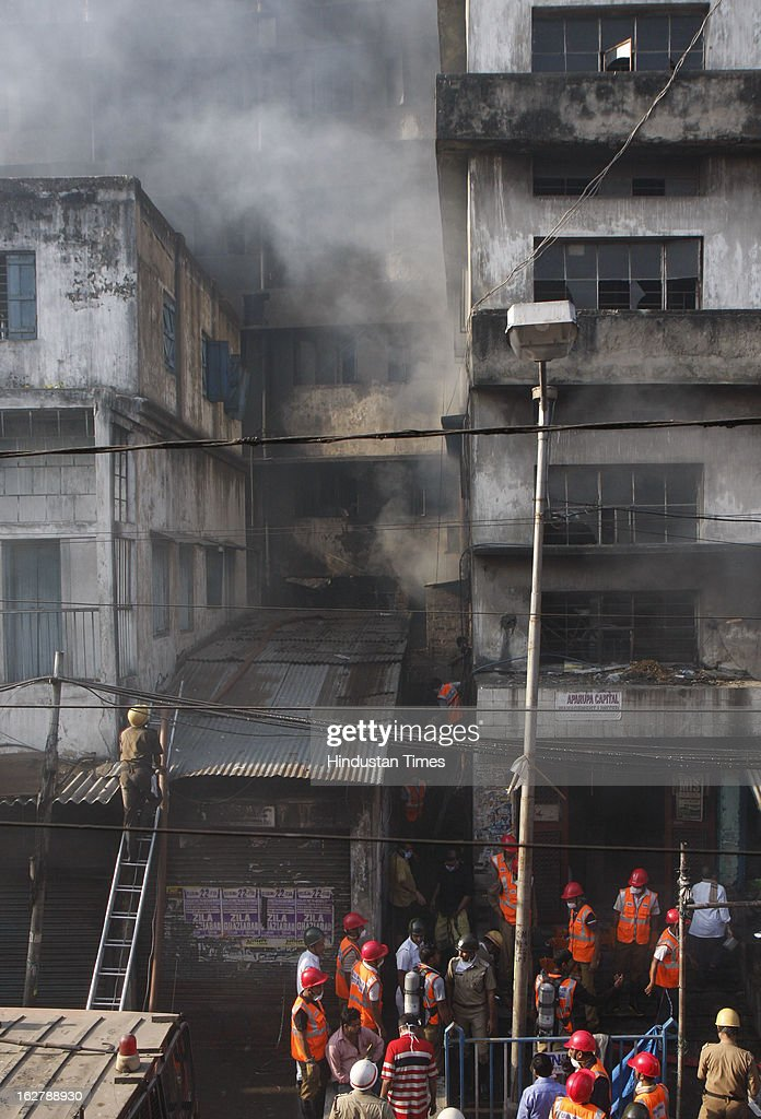 Fire brigade and Civil Defence personnel during rescue operation after fire engulfed a multi-storey market complex on February 27, 2013 in Kolkata, India. At least 19 people were killed in it. A dozen people were also critically injured in the fire that broke out at about 3 am at Sealdah in Central Kolkata, when many victims (Labours & shop keepers) were asleep. Even as 26 fire tenders battled the leaping flames and firemen scrambled to rescue people, many were feared trapped inside the market that houses plastic items, thermocol and paper godowns.